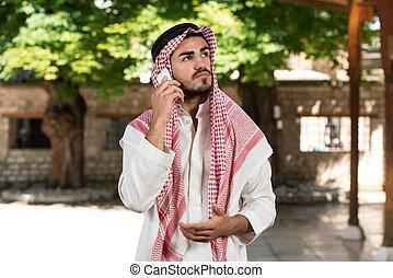 Arab Saudi Emirates Man Using A Smart Phone
