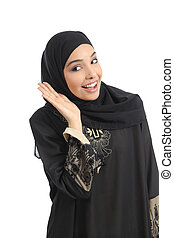 Arab saudi emirates woman gesturing listening with a hand on ear isolated on a white background