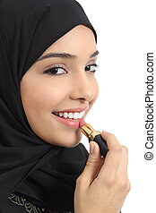Arab saudi emirates woman painting her lips with a lipstick