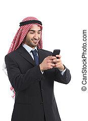Arab saudi executive smiling and using a smart phone