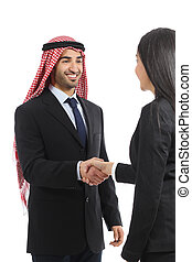 Arab saudi happy businessman handshaking in a negotiation