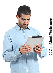 Arab saudi man reading a tablet reader isolated