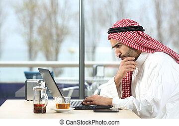 Arab saudi man worried with laptop
