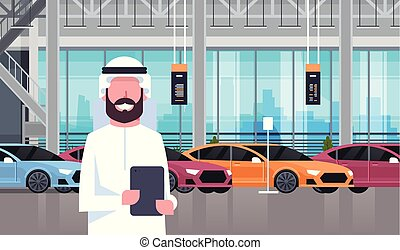 Arab Seller Man In Cars Dealership Center Showroom Interior Over Set Of New Modern Vechicles