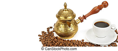 Arab small copper coffee pot with cup and coffee beans isolated on white. Wide photo. Free space for text.