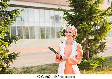 Arab Student holding a folder