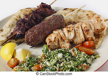 Arab style barbecue meal with tabouleh - Various barbecued...