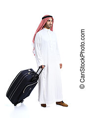 Arab traveler saudi man carrying a suitcase