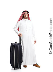 Arab traveler saudi man waiting with a suitcase