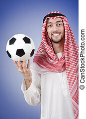 Arab with football in studio shooting