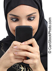Arab woman addicted to the smartphone isolated on a white...