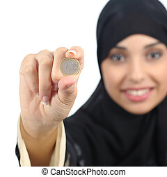 Arab woman holding and showing an euro coin