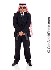 arabian bodyguard holding handguns - arabian bodyguard...