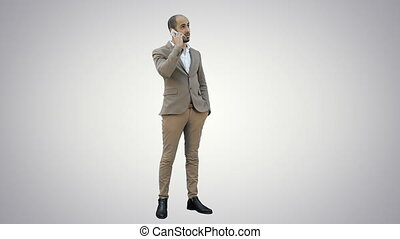 Arabian business man talking on the phone on white background.