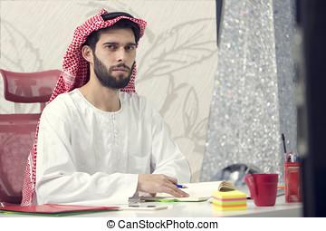 Arabian business man working on Laptop in the office