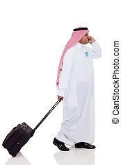 arabian business traveler talking on cell phone isolated on...