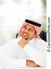 Arabian businessman daydreaming - cheerful Arabian...