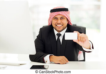 arabian businessman handing business card