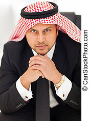 arabian businessman in office