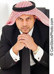 arabian businessman in office