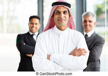 arabian businessman in office with team