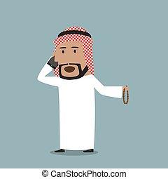 Arabian businessman talking on the mobile phone