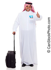 arabian businessman withl luggage giving thumb up