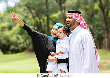 arabian family in the forest - cute arabian family looking...