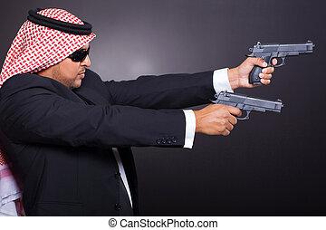 arabian hit man shooting with guns