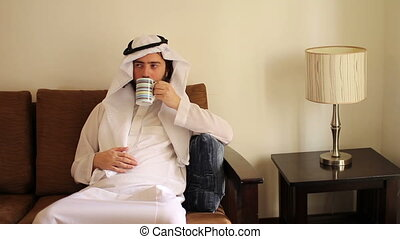 Arabian man drink coffee