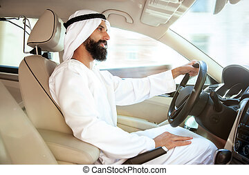Arabian saudi businessman driving hir car