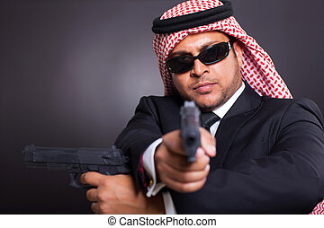 arabian spy with two handguns
