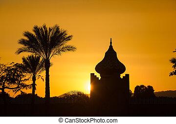 Arabian Sunset - arabian orange sunset with building and...