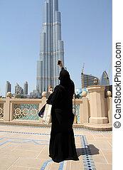 Arabian tourist woman - An arabian woman with traditional...