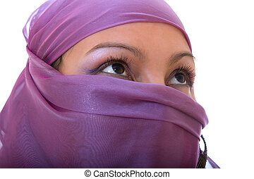 Arabian woman with her face covered - arabian girl in purple...