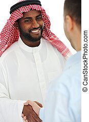 Arabic and european american business man making a deal and handshaking