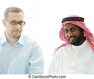 Arabic black and caucasian men work