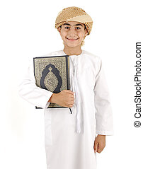 Arabic boy with Koran isolated