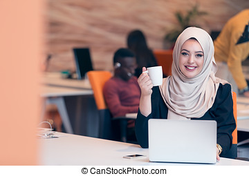 Arabic business woman wearing hijab,working in startup...