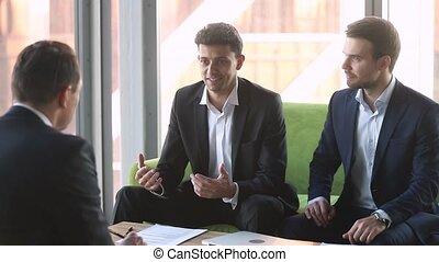 Arabic businessman handshake caucasian partner sing...
