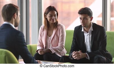 Arabic businessman talk to caucasian customer sign contract...