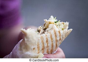 arabic chicken shawarma on the street, blured background