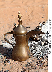 Arabic coffee pot at a fireplace in the desert. Abu Dhabi, United Arab Emirates