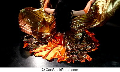 Arabic dancer sit, flap with wing