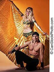 Arabic dancer with a handsome men performing fire show
