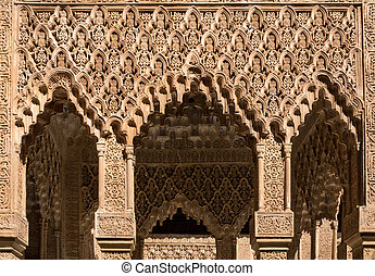 Arabic inscribed repeating arches in Alhambra palace Granada...