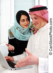 Arabic man and woman with laptop