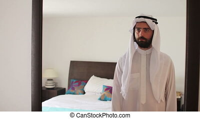 Arabic man dressing