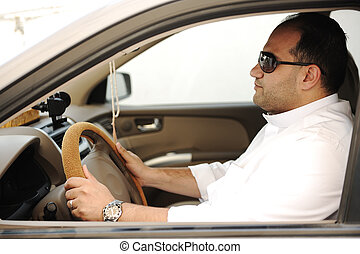 Arabic man driving a car