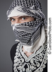 arabic man in headscarf